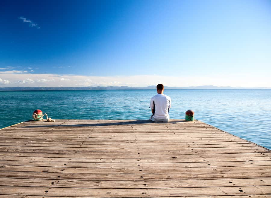 bigstock-young-man-relax-siting-on-pier-12751739